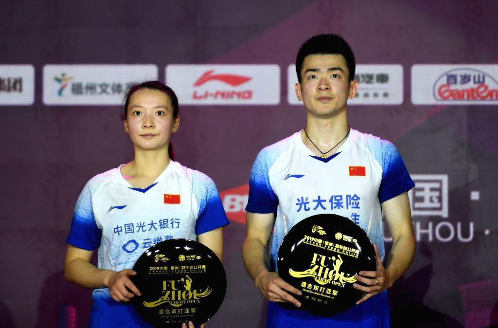 FUZHOU, Nov. 10, 2019 - Zheng Siwei (R)/Huang Yaqiong of China pose during the awarding ceremony after the mixed doubles final match between Wang Yilyu/Huang Dongping of China and Zheng Siwei/Huang ...