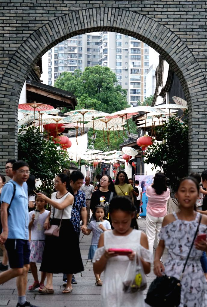 FUZHOU, Oct. 9, 2017 - Tourists enjoy themselves at a scenic area in Fuzhou, capital of southeast China's Fujian Province, Oct. 8, 2017. A total of 705 million tourists traveled around the country ...