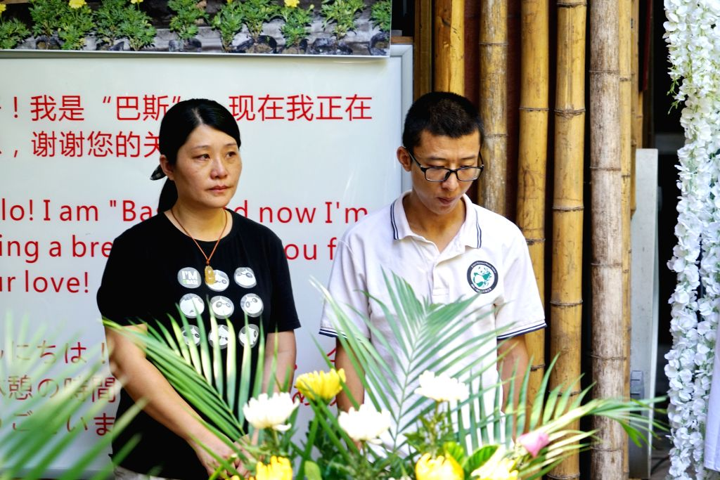 FUZHOU, Sept. 14, 2017 - Xu Suhui (L) and Luo Weiming, staff workers of the Strait (Fuzhou) Giant Panda Research and Exchange Center, attend a press conference on the death of giant panda Basi in ...