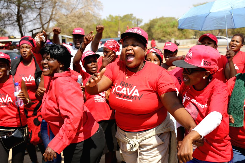 GABORONE, Oct. 24, 2019 - Supporters of the ruling Botswana Democratic Party (BDP) attend a gathering as the ballot counting of the parliamentary election continues in Gaborone, capital of Botswana, ...