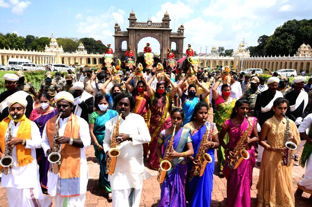 Gajapade, the group of Dasara Elephants receive a traditional welcome at Mysuru Palace on Oct 2, 2020.