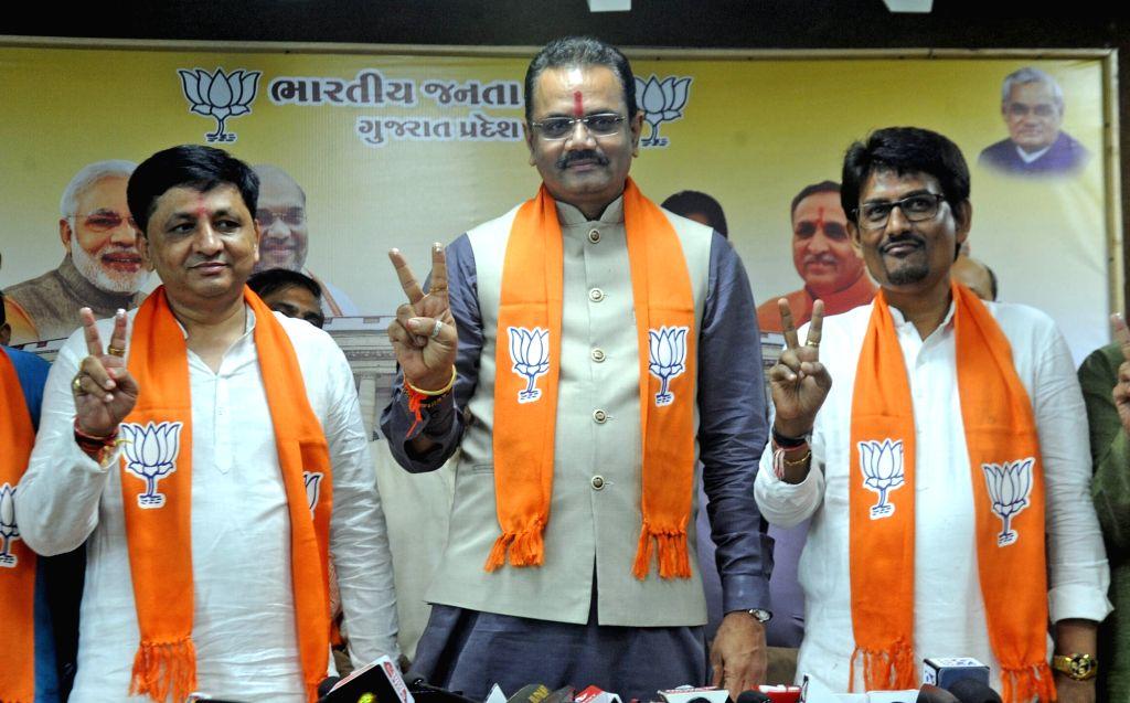 Gandhinagar: Former Congress legislators Alpesh Thakor and Dhavalsinh Zala join the BJP in presence of Gujarat BJP President Jitu Vaghani, in Gandhinagar, on July 18, 2019. (Photo: IANS)