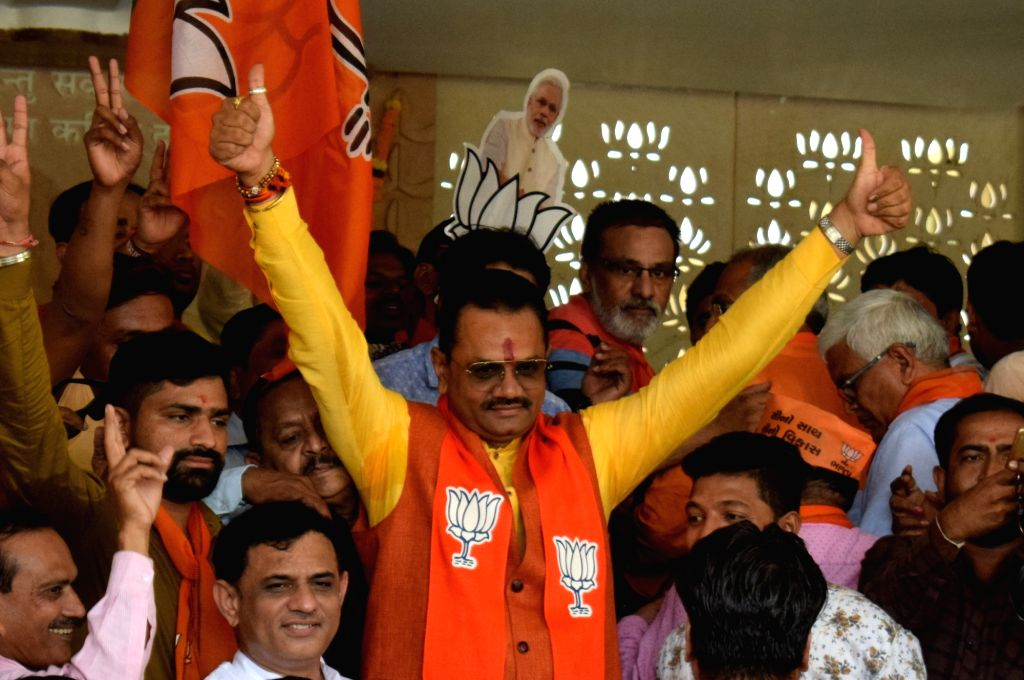Gandhinagar: Gujarat BJP President Jitubhai Vaghani celebrates with party workers after the party led by Prime Minister Narendra Modi was set to retain power for another five years after making a sweep of the 2019 Lok Sabha battle and mauling the opp - Narendra Modi and Megh Modi