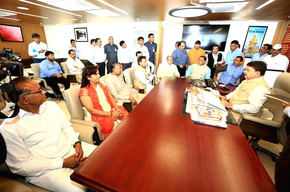 Gandhinagar: Gujarat Chief Minister Vijay Rupani and state Assembly Speaker Rajendra Trivedi with the four newly-elected legislators of Gujarat's ruling BJP - Jawahar Chawda (Manavadar), Asha Patel (Unjha), Purshottam Sabaria (Dhrangadhara) and Ragha - Vijay Rupani, Asha Patel and Raghavji Patel