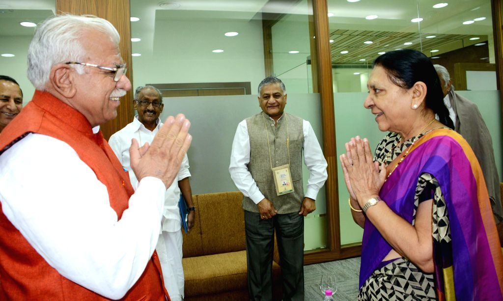 Haryana Chief Minister Manohar Lal Khattar meets Gujarat Chief Minister Anandiben Patel at the CMs Session of the Pravasi Bharatiya Divas 2015, in Gandhinagar, Gujarat on Jan 9, 2015. ... - Manohar Lal Khattar, Anandiben Patel and K. Singh