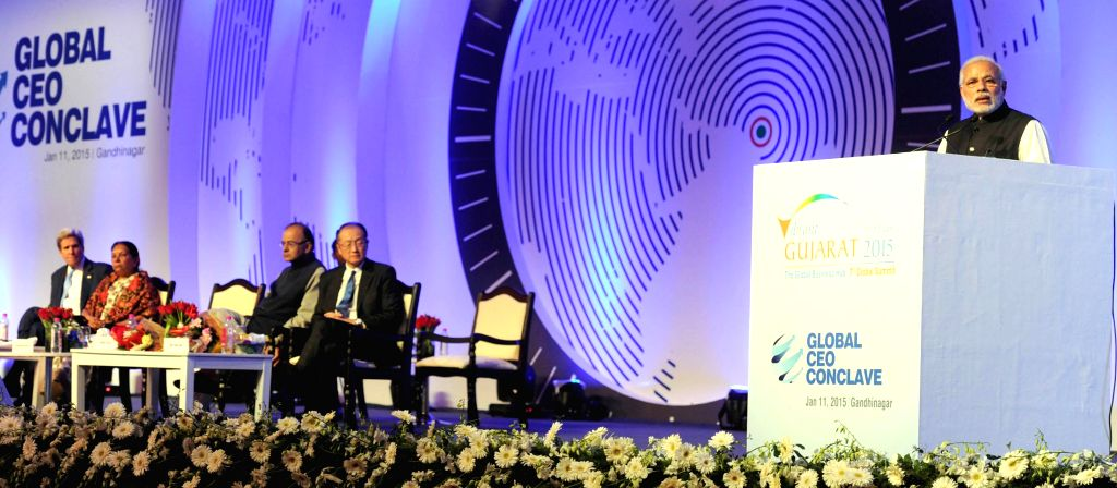Prime Minister Narendra Modi addresses at the global CEO conclave, in Gandhinagar, Gujarat on Jan 11, 2015. Also seen the Union Minister for Finance, Corporate Affairs and Information ... - Narendra Modi, Arun Jaitley and Anandiben Patel