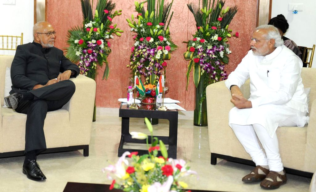 Prime Minister Narendra Modi during a meeting with the President of Guyana, Donald Ramotar, in Gandhinagar, Gujarat on Jan 8, 2015. - Narendra Modi