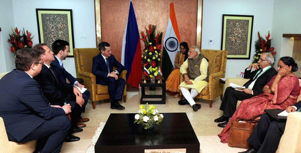 Prime Minister Narendra Modi during a meeting with the Governor of Astrakhan (Russia), Alexander Zhilkin, in Gandhinagar, Gujarat on Jan 11, 2015. - Narendra Modi