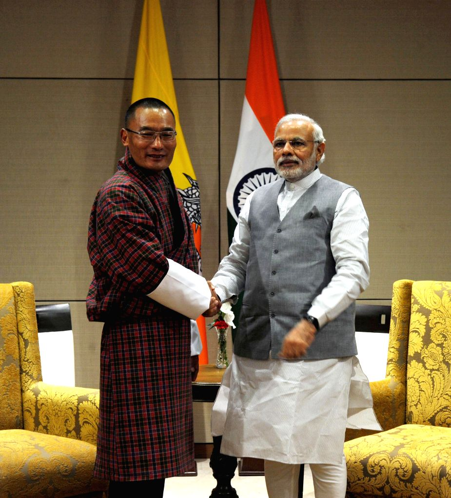 Prime Minister Narendra Modi meets Bhutan Prime Minister Tshering Tobgay at New Sachivalaya, in Gandhinagar, Gujarat on Jan 10, 2015. - Narendra Modi
