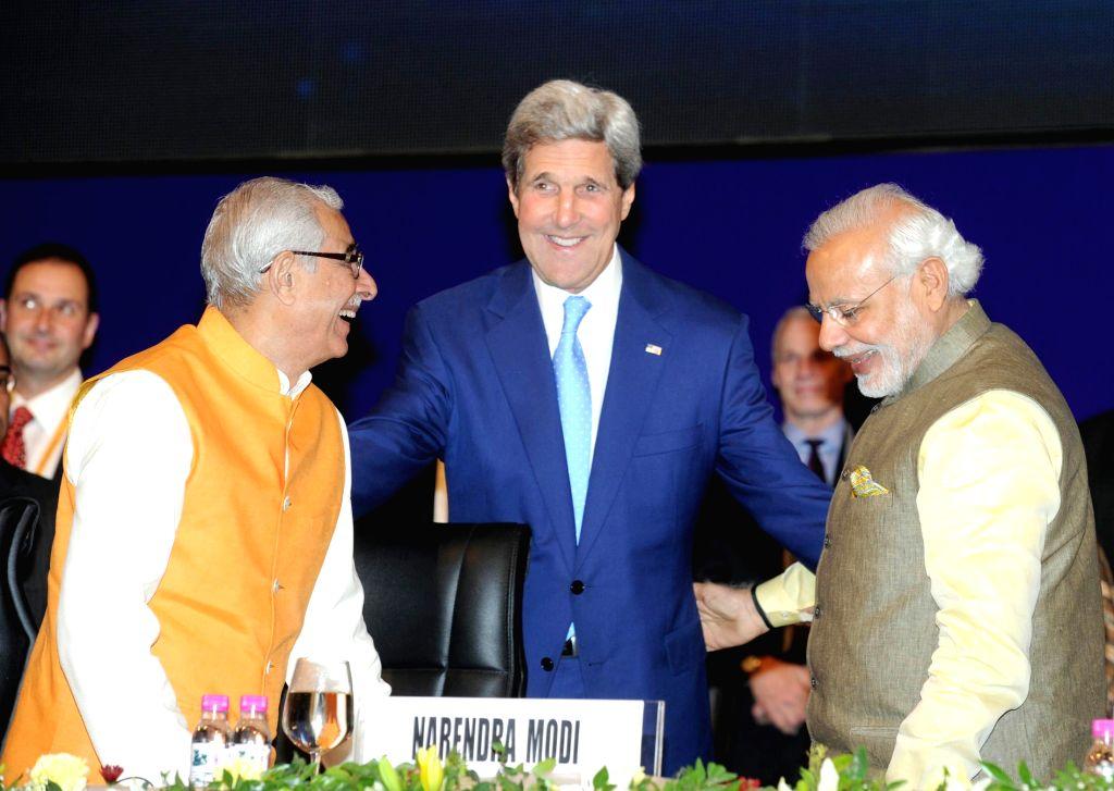 Prime Minister Narendra Modi with the US Secretary of State John Kerry, at the 7th Vibrant Gujarat Global Summit 2015, in Gandhinagar, Gujarat on Jan 11, 2015. Also seen Gujarat  ... - Narendra Modi and P. Kohli