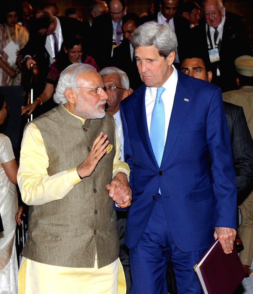 Prime Minister Narendra Modi with the US Secretary of State John Kerry at the 7th Vibrant Gujarat Global Summit 2015, in Gandhinagar, Gujarat on Jan 11, 2015. - Narendra Modi