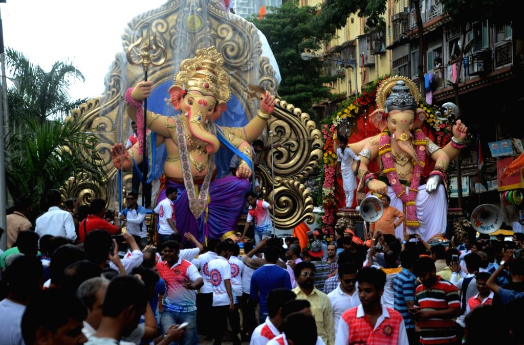 Ganesh idols being taken to their respective pandals from a Mumbai workshop on Aug 14, 2016.