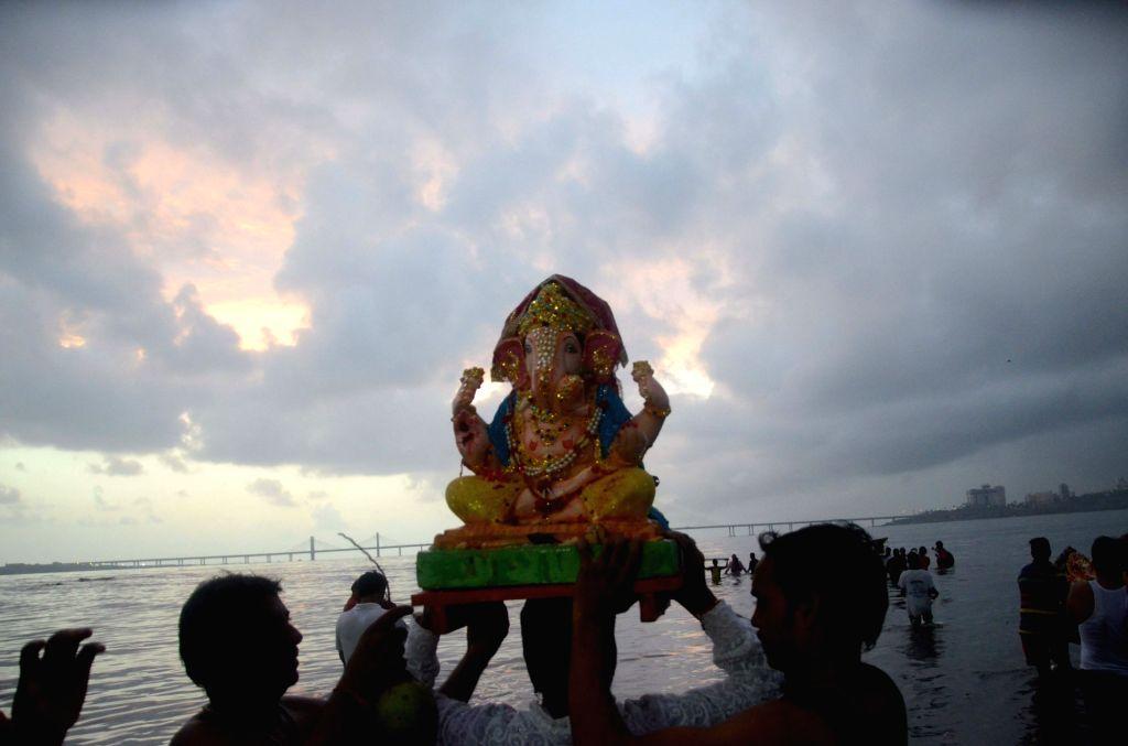 Ganesha immersions underway at Shivaji Park sea beach in Mumbai, on Sept 9, 2016.