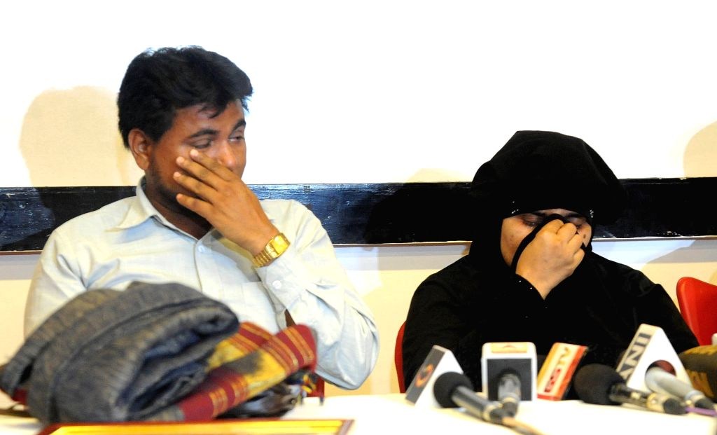 Gang-rape victim Bilkis Bano amd her husband Yakub Rasool get emotional during a press conference in Ahmedabad, on May 11, 2017.  Bano was 19 years old and pregnant when she was ...