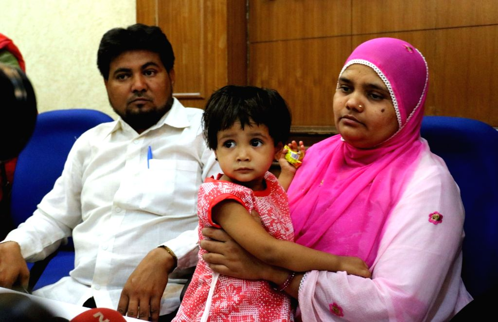 Gang-rape victim Bilkis Bano with her husband Yakub Rasool during a press conference in New Delhi, on May 8, 2017.  Bano was 19 years old and pregnant when she was subjected to the horror ...