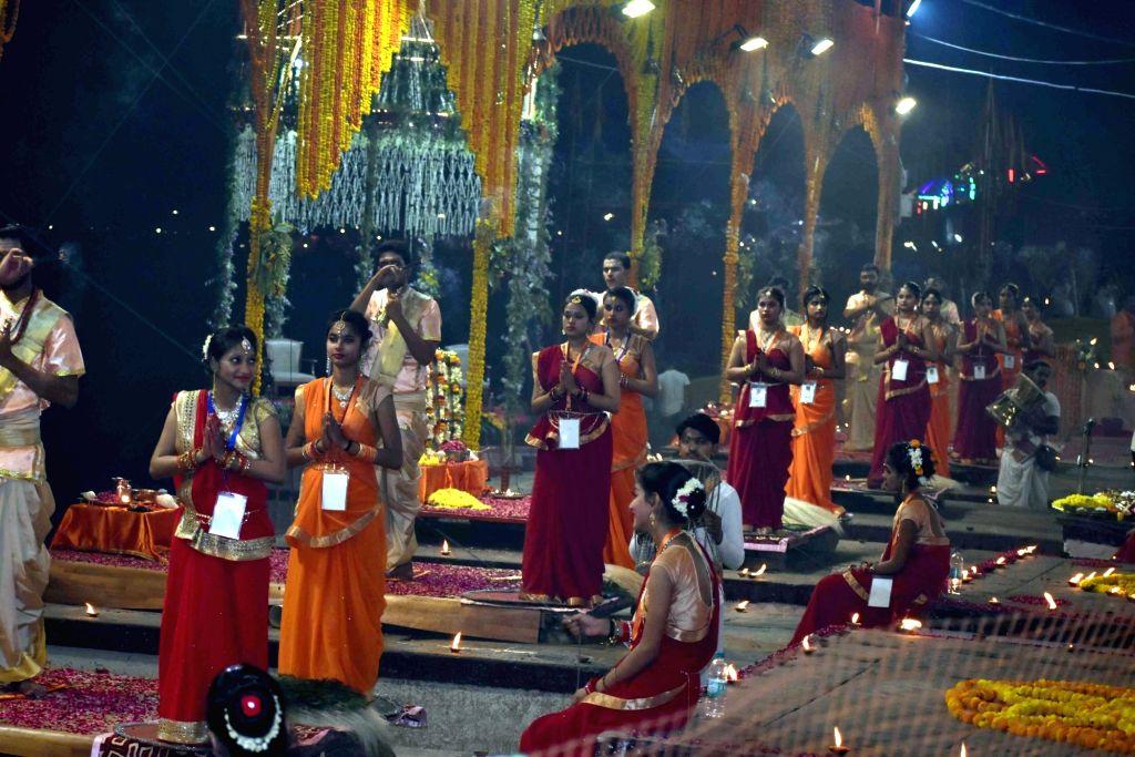 Ganga aarti' underway at Dashashwamedh Ghat with Prime Minister Narendra Modi, BJP chief Amit Shah, Uttar Pradesh Chief Minister Yogi Adityanath and Uttar Pradesh BJP President Mahendra ... - Narendra Modi, Amit Shah and Mahendra Nath Pandey