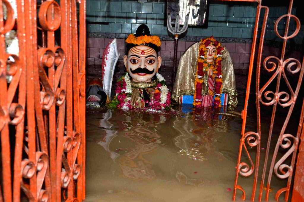 Ganga water inundates a temple in Varanasi on Aug 23, 2016. (Photo: IANS