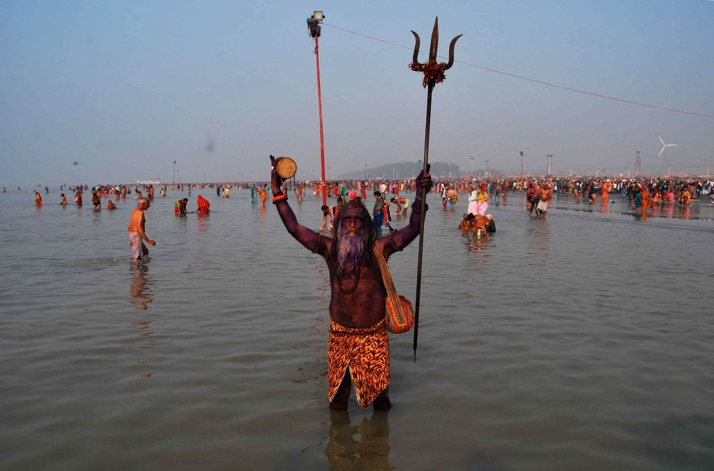 An ascetic at the  Gangasagar island some 160 km south of Kolkata,  on `Makar Sankranti`, on Jan 14, 2015.
