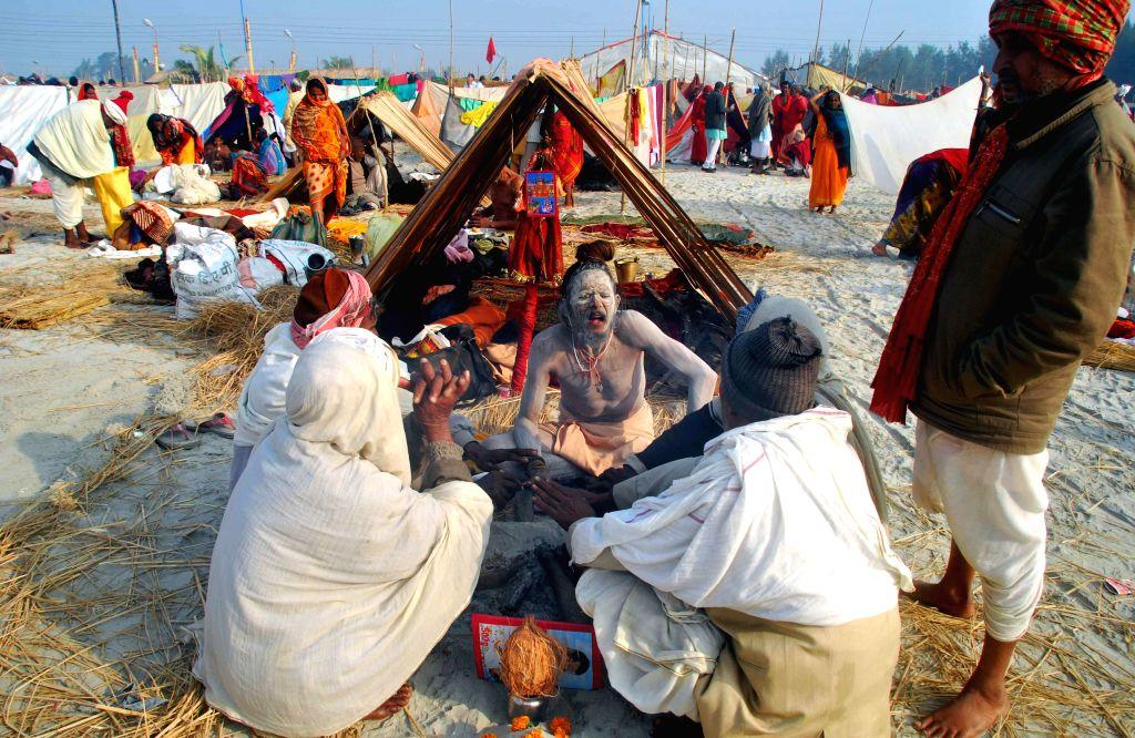 An ascetic at the Gangasagar island, on `Makar Sankranti`,  some 160 km south of Kolkata on Jan 15, 2015.