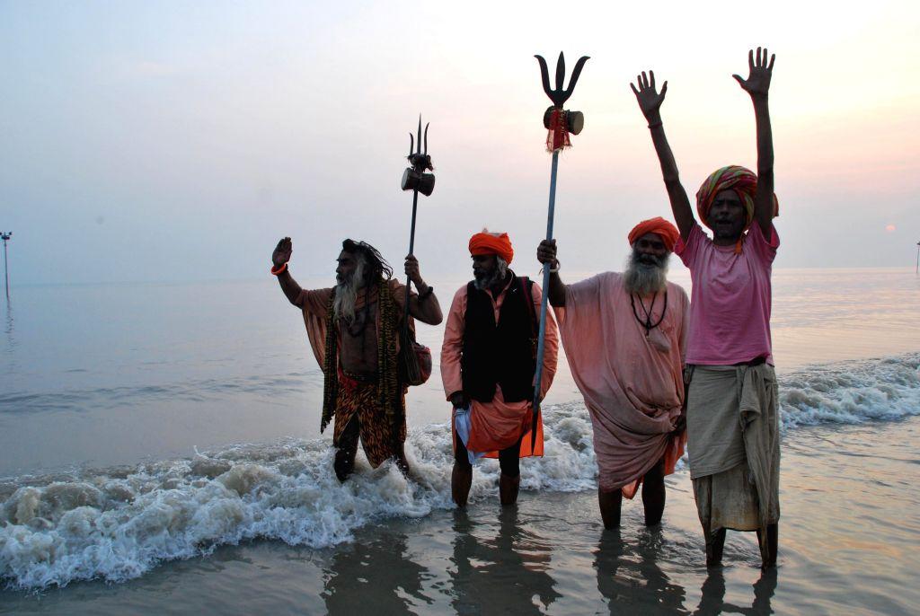 Ascetics  at the Gangasagar island, some 160 km south of Kolkata, a day ahead of `Makar Sankranti` on Jan 13, 2015.