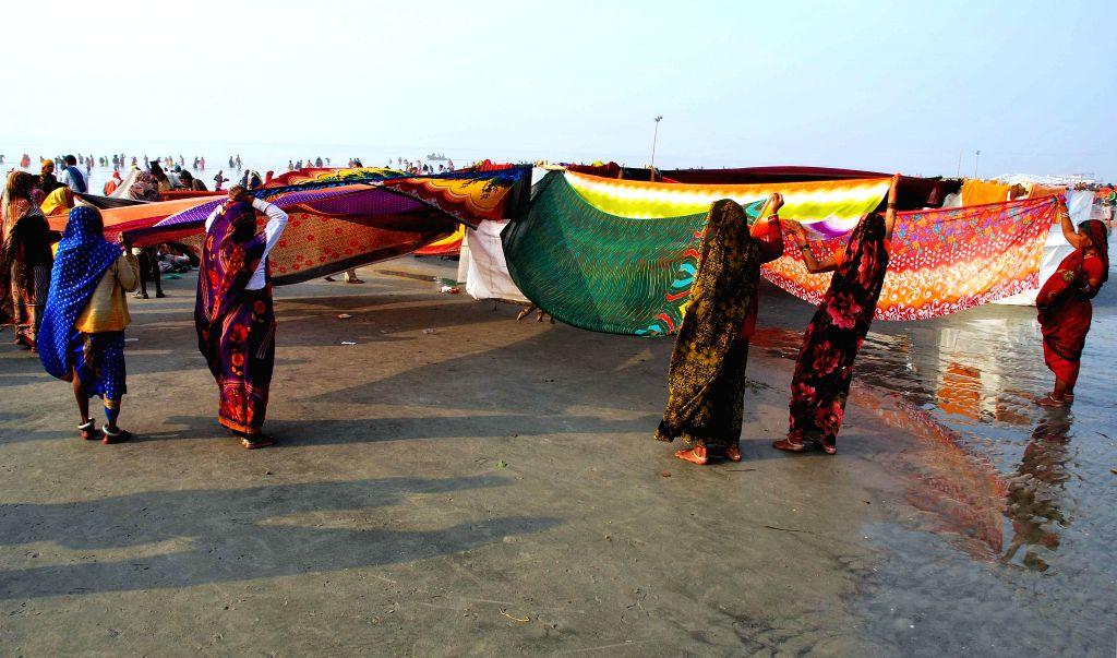Devotees at the  Gangasagar island some 160 km south of Kolkata,  on `Makar Sankranti` on Jan 14, 2015.