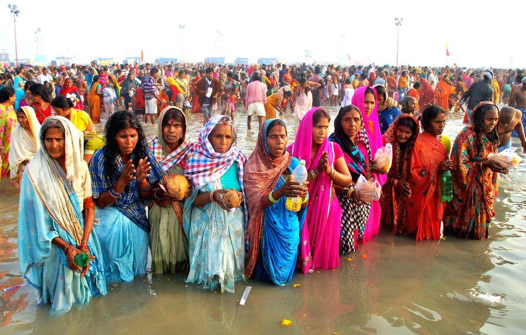Devotees perform rituals at the  Gangasagar island, some 160 km south of Kolkata, on `Makar Sankranti` on Jan 14, 2015.
