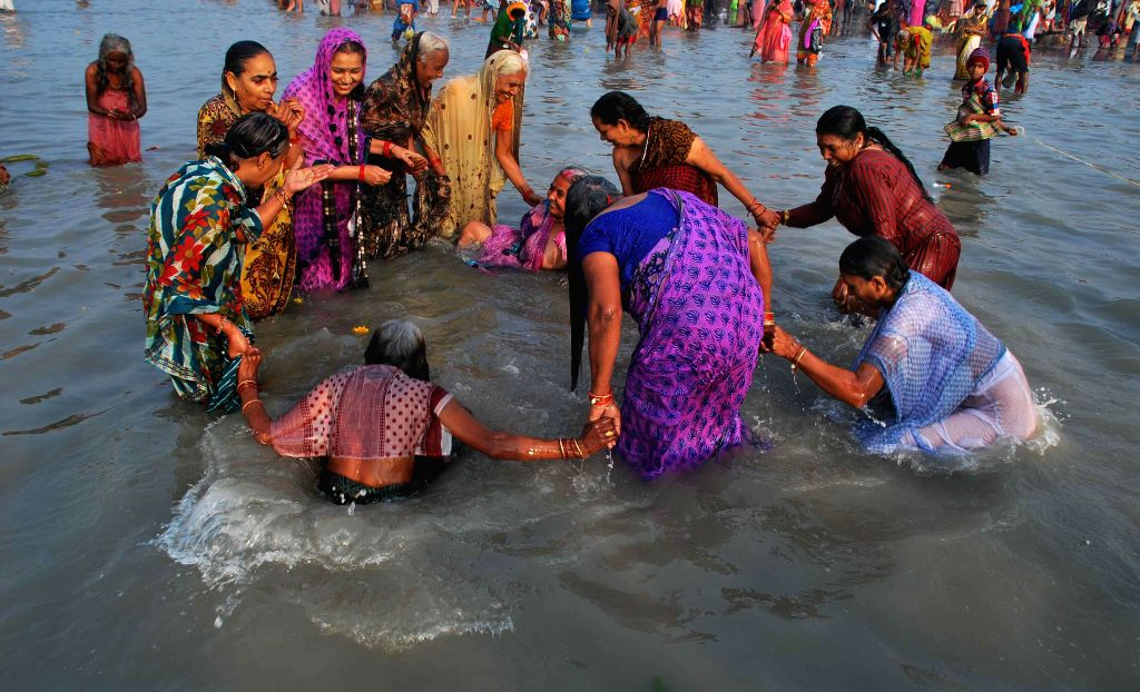 Devotees take holy dip on `Makar Sankranti` at the  Gangasagar island some 160 km south of Kolkata,  on Jan 14, 2015.