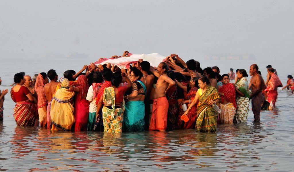 People take holy dip at the Gangasagar island, on `Makar Sankranti`,  some 160 km south of Kolkata on Jan 15, 2015.