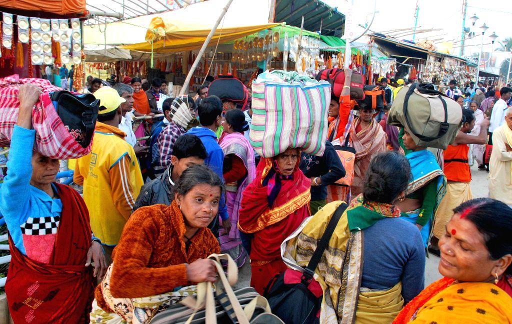 Pilgrims arrive at the Gangasagar island, some 160 km south of Kolkata on Jan 12, 2015.