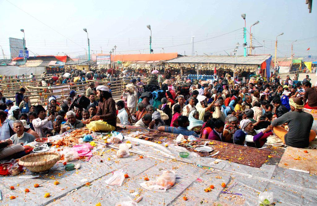 Pilgrims throng Kapilmuni's Ashram after taking a holy dip on Makar Sankranti at Gangasagar island some 160 km south of Kolkata on Jan 14, 2015.