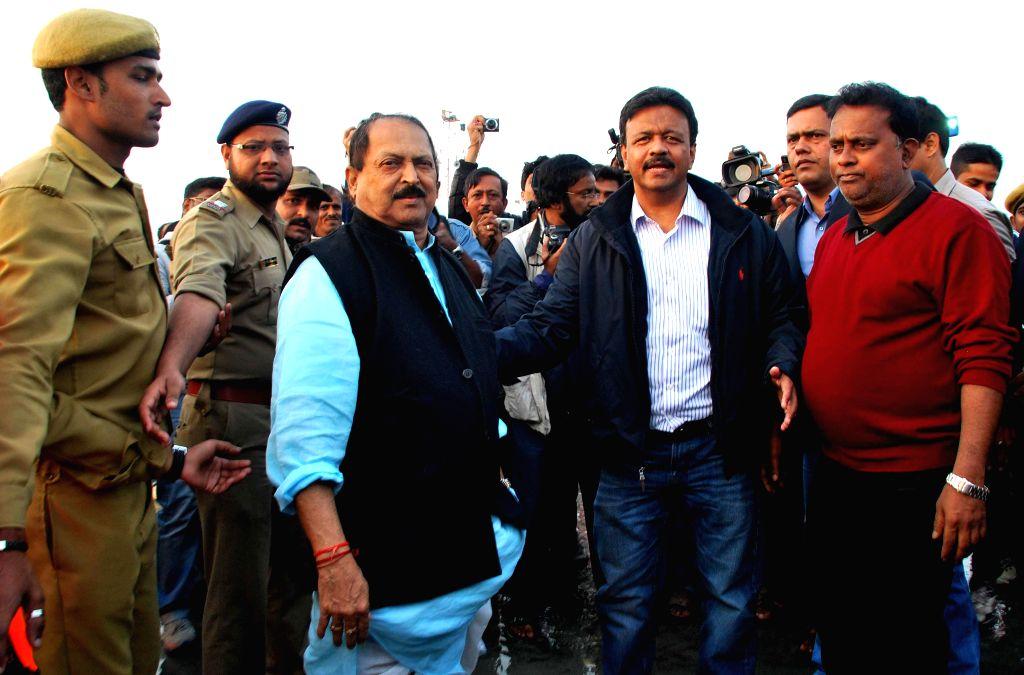 West Bengal Ministers Subrata Mukherjee and Firhad Hakim visit the Gangasagar island, some 160 km south of Kolkata a day ahead of `Makar Sankranti` on Jan 13, 2015. - Subrata Mukherjee and Firhad Hakim