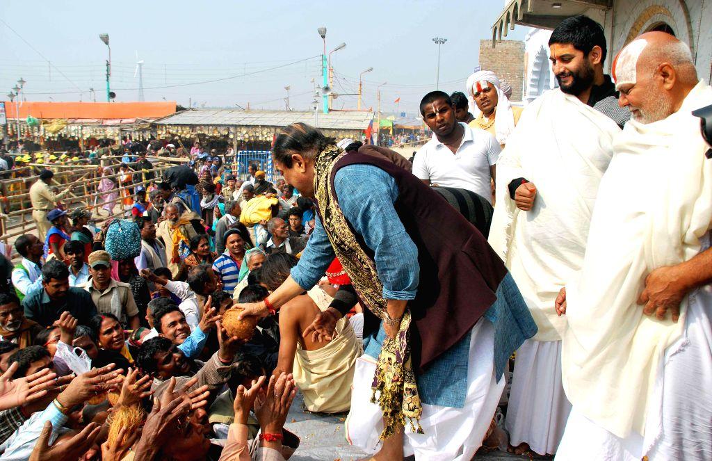 West Bengal Panchayat Minister Subrata Mukherjee distributes prasad to the pligrims at Kapilmuni's Ashram on Makar Sankranti at Gangasagar island some 160 km south of Kolkata on Jan 14, .. - Subrata Mukherjee