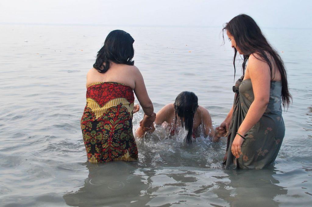 Women take holy dip at the Gangasagar island, on `Makar Sankranti`,  some 160 km south of Kolkata on Jan 15, 2015.