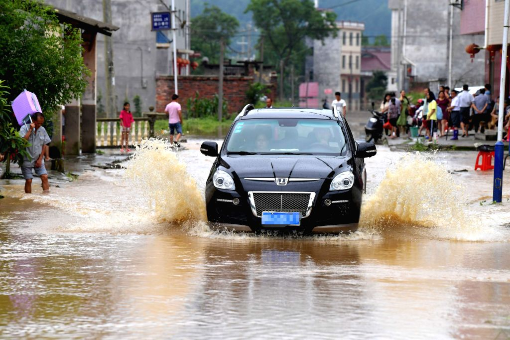 GANZHOU, June 11, 2019 - A car runs on a waterlogged road in Zaizhong Township of Yongxin County, east China's Jiangxi Province, June 9, 2019. More than two million residents have been affected by ...