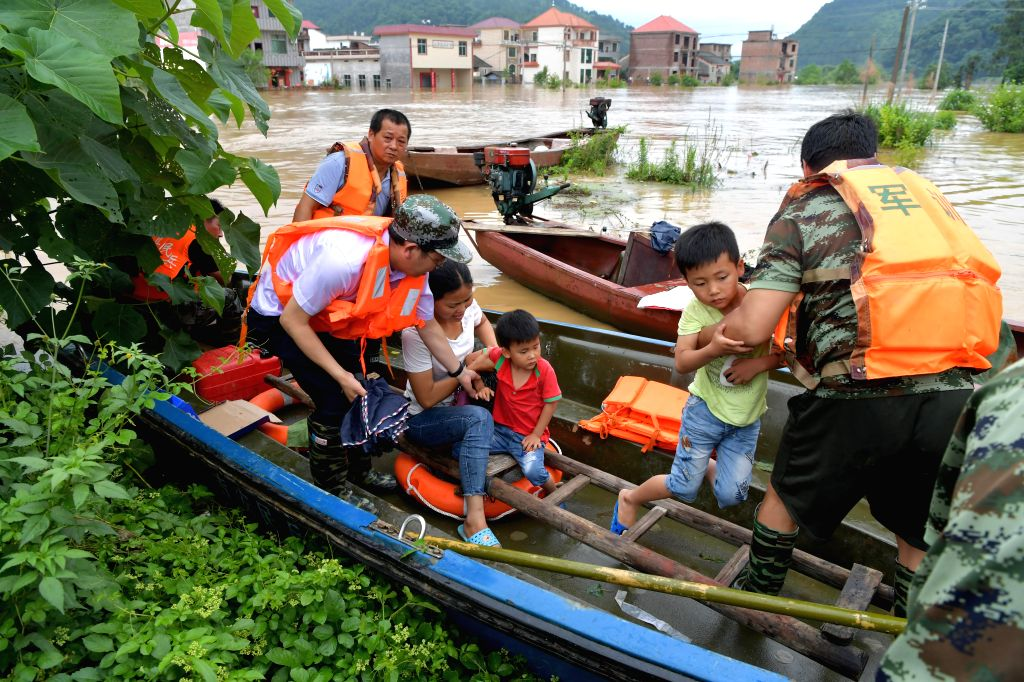 GANZHOU, June 11, 2019 - Rescuers transfer flood-affected residents in Zaizhong Township of Yongxin County, east China's Jiangxi Province, June 9, 2019. More than two million residents have been ...