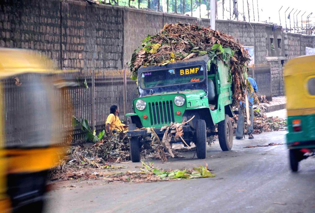 Garbage being filled in to the BBMP jeep at KR Market during Ganesha festival in Bangalore on Aug. 30, 2014.