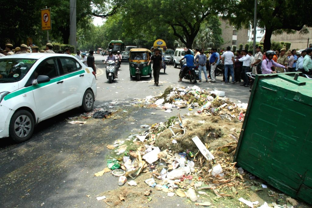Garbage lying unattended in the middle of a street as NDMC workers protest, in New Delhi on May 24, 2018.