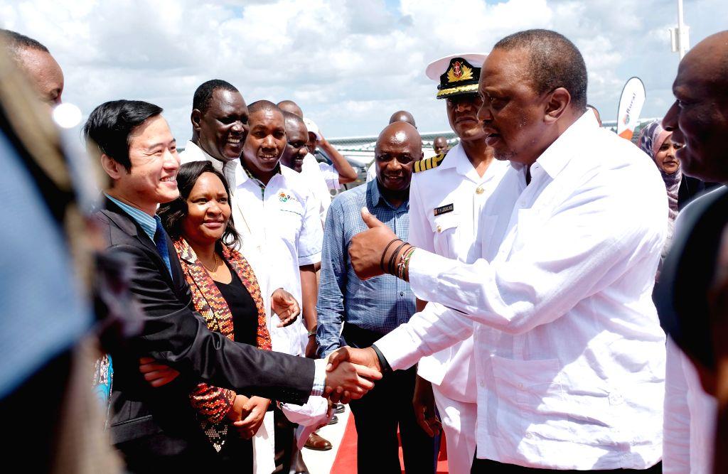 GARISSA, Dec. 14, 2019 - Kenyan President Uhuru Kenyatta (R) attends the launching ceremony of the 50 MW solar power farm in Garissa, Kenya, Dec. 13, 2019. The plant, designed and built by the EPC ... - China Jiangxi Corporation
