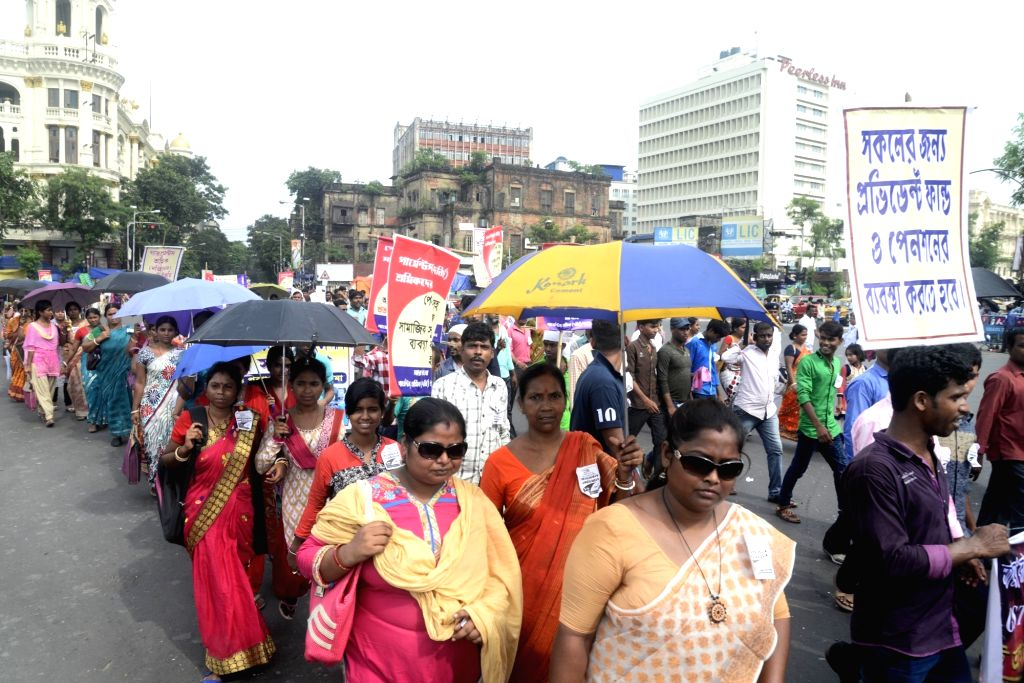 Garments workers participate in a protest rally against recent implementation of Goods and Service Tax (GST) over dress and garment industry in Kolkata on Aug 16, 2017.