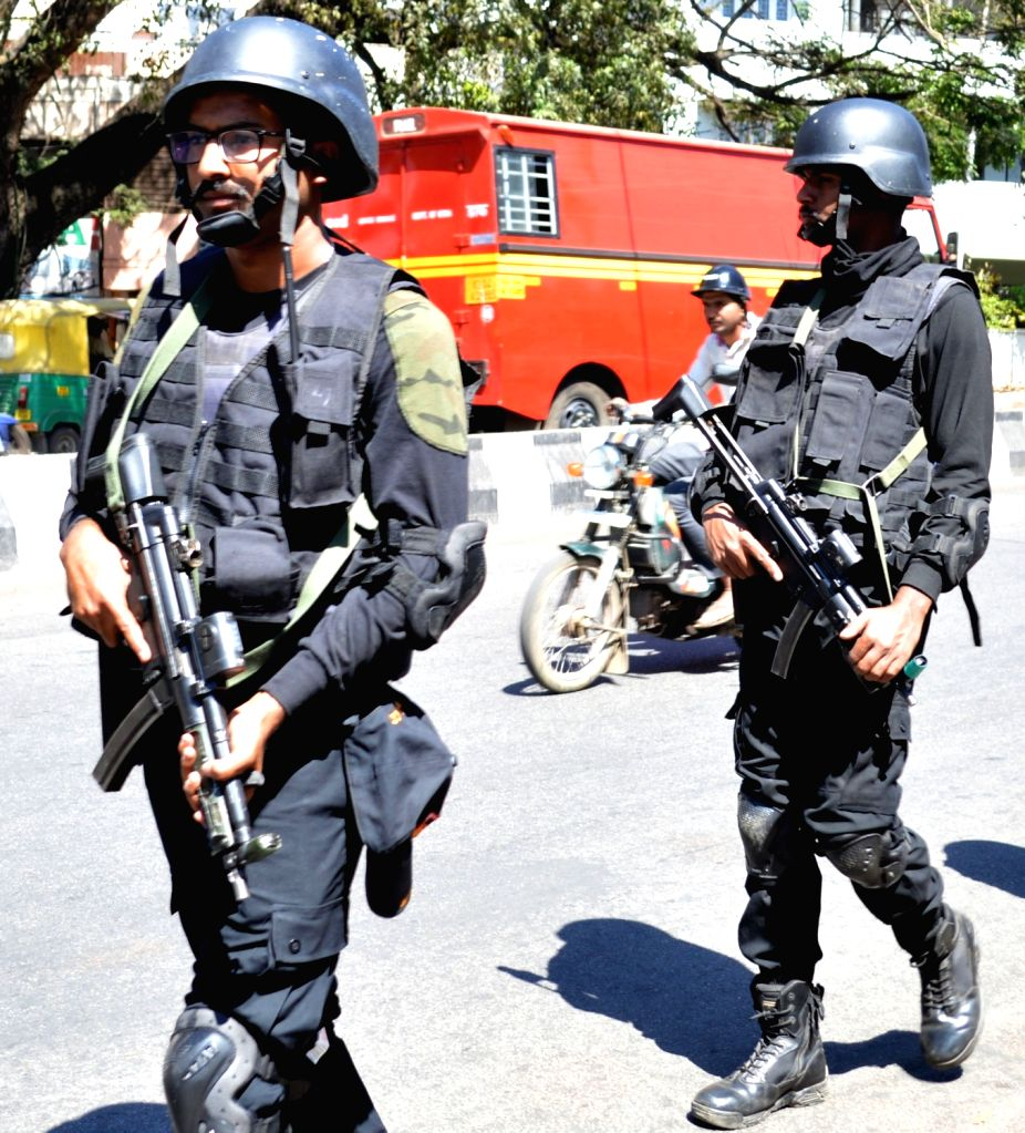Garuda Force personnel patrol the Race Course Road amid high security arrangements in place in view of the upcoming Republic Day celebrations, in Bengaluru on Jan 24, 2020.