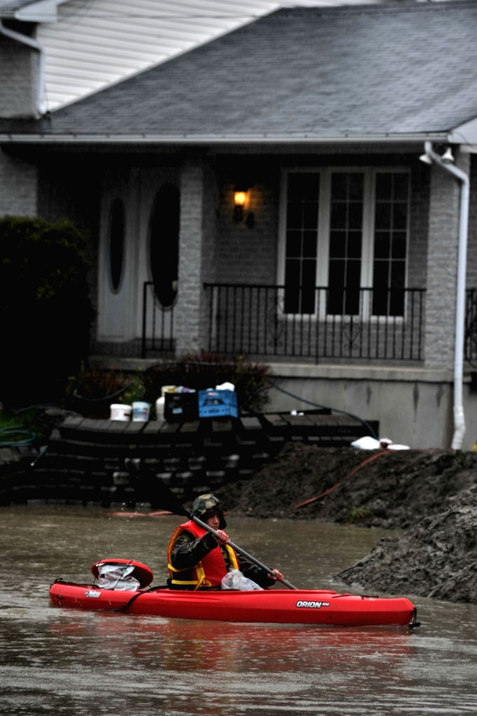 GATINEAU, May 6, 2017 - A man rows a boat in the street of flooded Gatineau, Quebec province of Canada, May 5, 2017. Several areas across Quebec is flooded as heavy rain has continued for days in ...