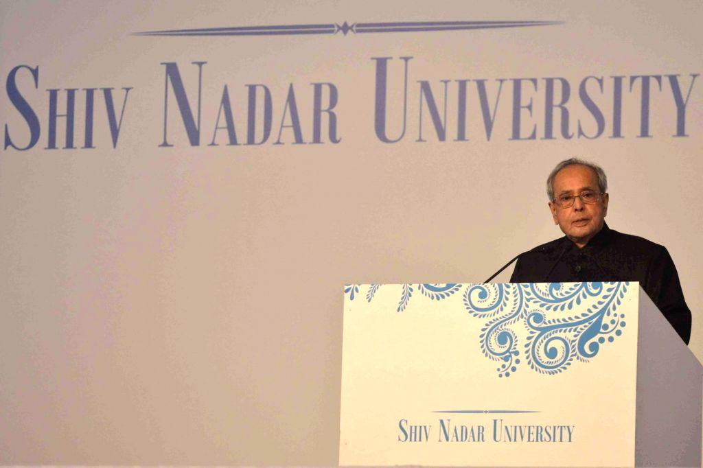 Gautam Buddha Nagar: President Pranab Mukherjee addresses during the inauguration of Shiv Nadar University, at Dadri, Gautam Buddha Nagar, in Uttar Pradesh on Jan 18, 2016. Also seen Uttar Pradesh ... - Pranab Mukherjee