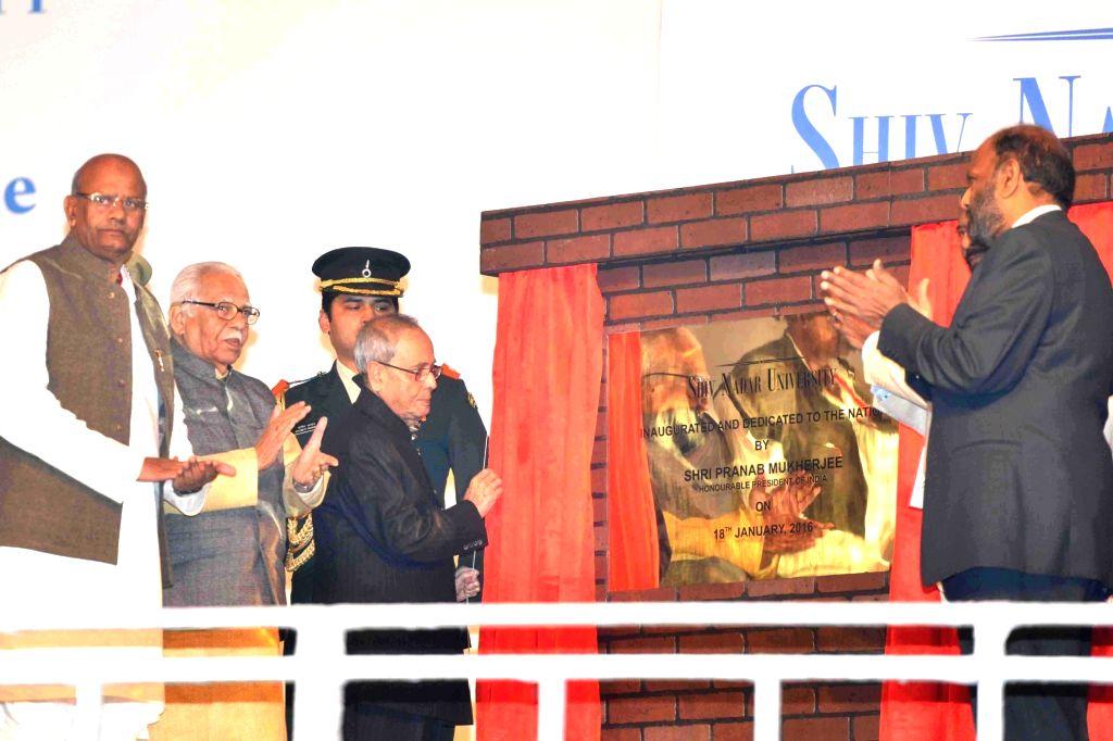 Gautam Buddha Nagar: President Pranab Mukherjee lays of the Foundation Stone of the Faculty Residential Campus, during the inauguration of Shiv Nadar University, at Dadri, Gautam Buddha Nagar, in ... - Pranab Mukherjee