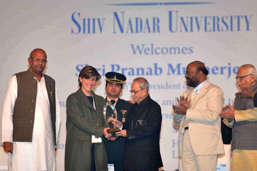 Gautam Buddha Nagar: President Pranab Mukherjee presents the HCL Citizen`s Grants Award, during the inauguration of Shiv Nadar University, at Dadri, Gautam Buddha Nagar, in Uttar Pradesh on Jan 18, ... - Pranab Mukherjee