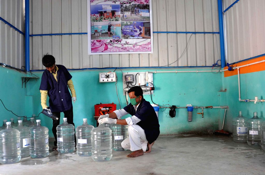 Gayghata : Founder of Sulabh International Bindeshwar Pathak during The 'Sulabh Drinking Water' project converts contaminated pond water into safe drinking water at Madhusudan kati village of ...