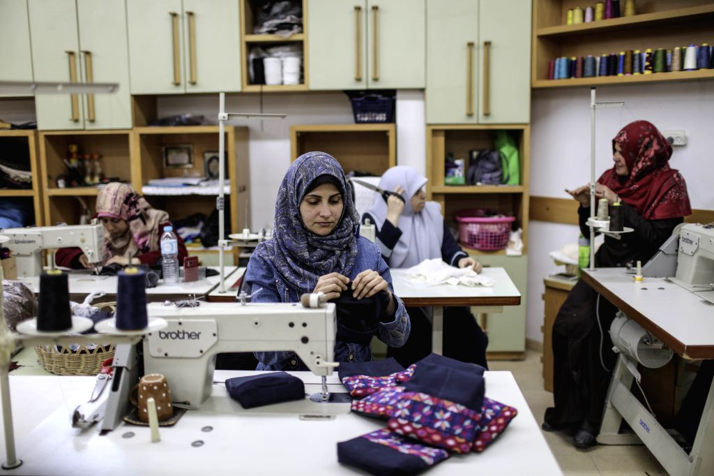 GAZA, April 18, 2017 - Palestinian deaf women work on embroidery at Atfaluna Society for Deaf Children in Gaza City, on April 18, 2017. The society provides service for about 15,000 deaf children and ...