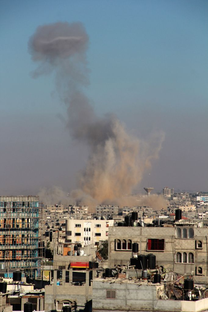 Smoke rises after Israeli air strikes in Rafah, southern Gaza Strip, Aug. 1, 2014. A 72-hour humanitarian ceasefire between Israel and Palestinian militant groups in ...