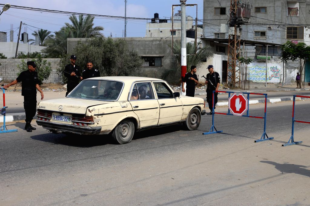 GAZA, Aug.17, 2017 - Palestinian members of Hamas security forces stop a vehicle at a checkpoint in the southern Gaza Strip city of Rafah, on Aug. 17, 2017. Two people including a suspected Islamic ...