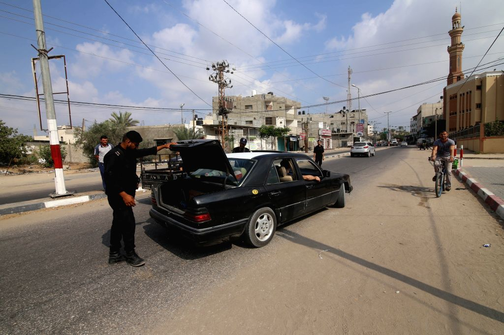 GAZA, Aug.17, 2017 - Palestinian members of Hamas security forces stop a vehicle at a checkpoint in the southern Gaza Strip city of Rafah, on Aug.17, 2017. Two people including a suspected Islamic ...