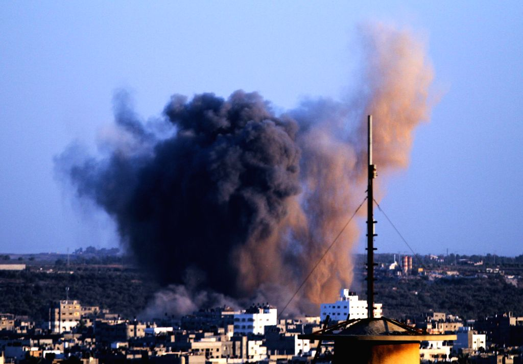 Smoke and dust rise after an Israeli strike hit Gaza City, on Aug. 20, 2014. Israel will step up the offensive in the Gaza Strip until rocket firing from there into ... - Benjamin Netanyahu